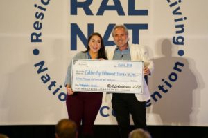 Gene & Isabelle Presenting Check — RAL National Convention 2018